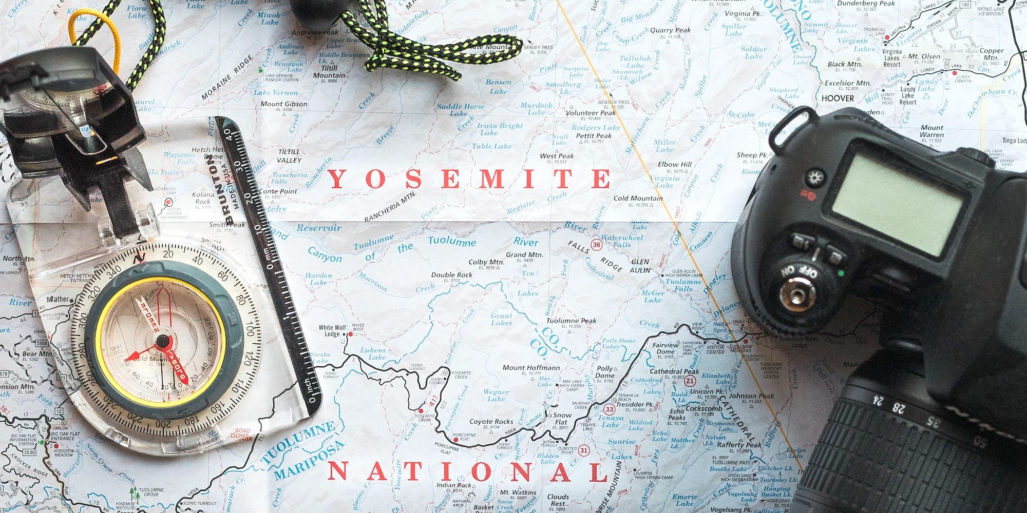Yosemite national park map with compass and camera sitting on top